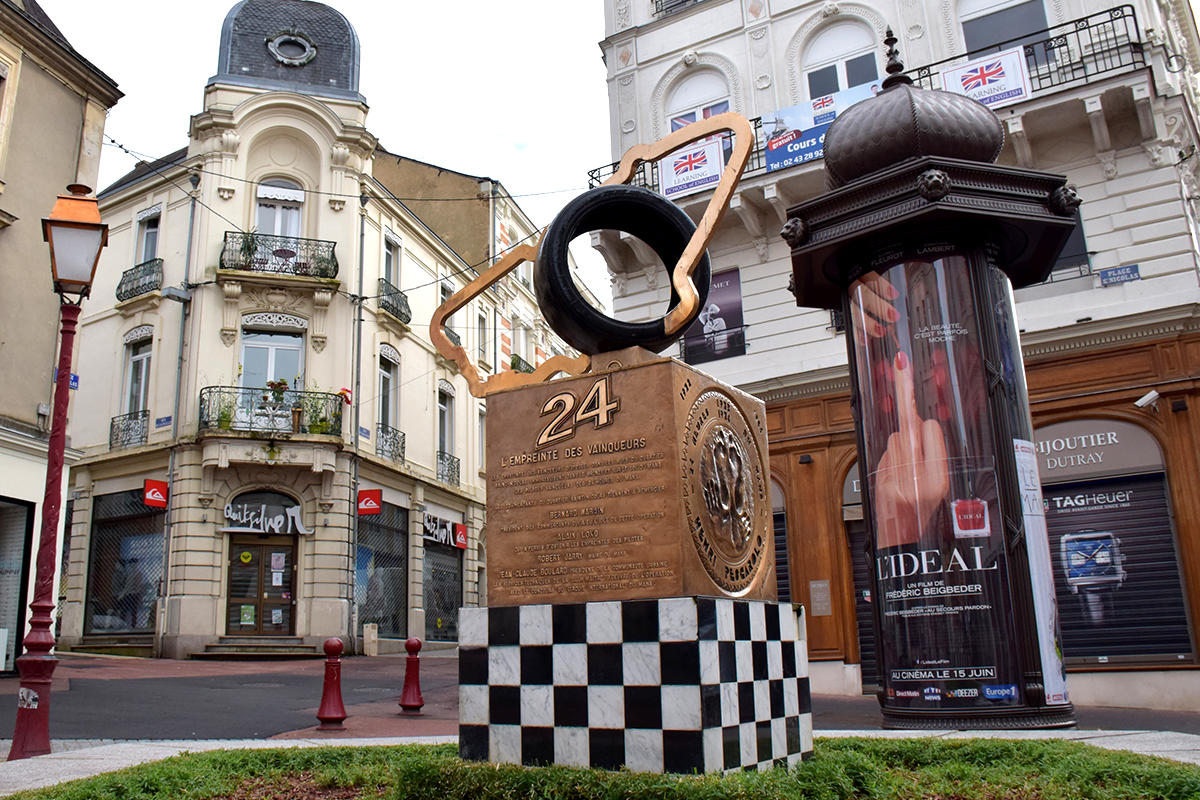 An art piece portraying the 24 Hours of Le Mans race placed in the town of Le Mans